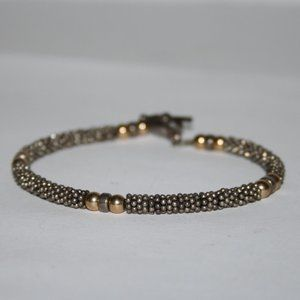 Beautiful rustic silver and gold toggle bracelet